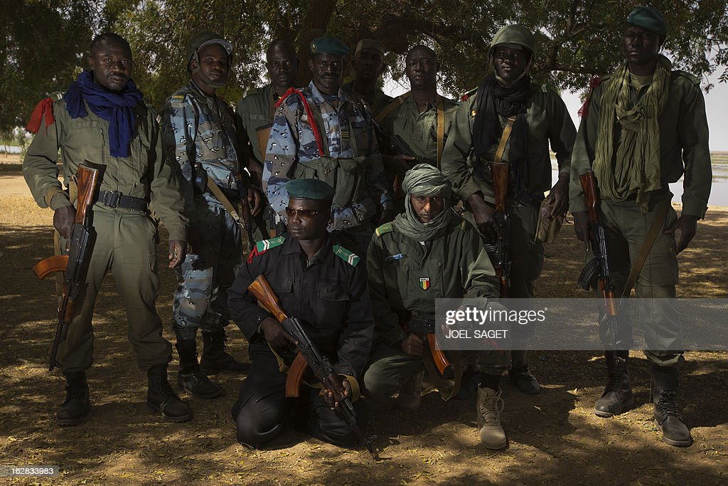 A group of Malian gendarmes pose on February 28, 2013 near the Niger river in the northern city of Gao. The Movement for Oneness and Jihad in West Africa (MUJAO) occupied Gao for nine months before it was recaptured by French and Malian troops in a French-led offensive on January 26.