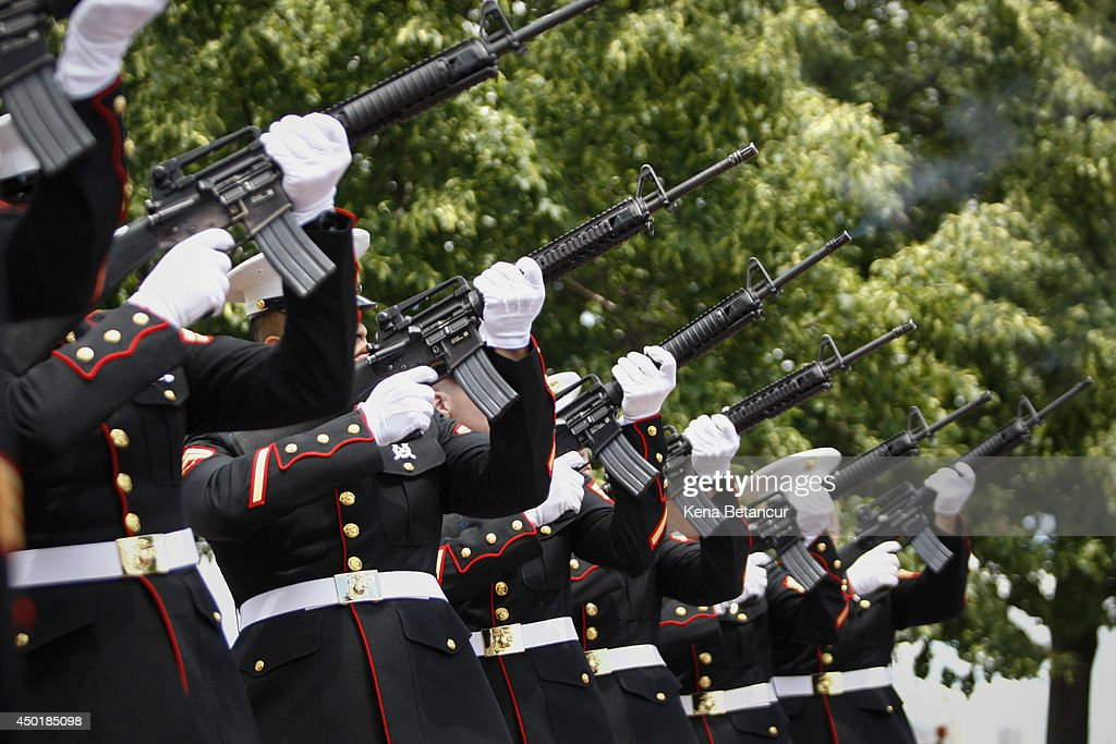 A group of Marines fire their arms during the Commemorating 70th Anniversary of DDay on June 06 2014 in New York City Three helicopters have showered...