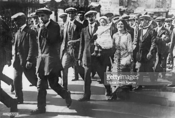 A group of married men on their conscription into the British Army Britain World War I 1st June 1916 One man is accompanied by his wife and child...