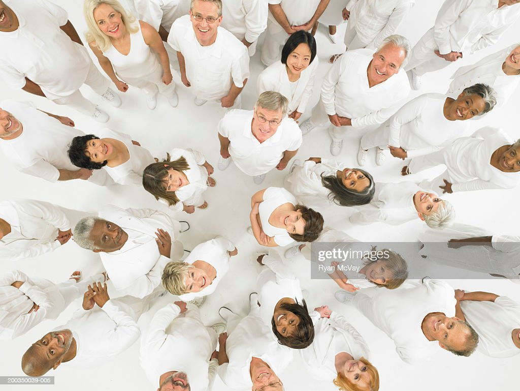 Group of mature men and women wearing white, looking up : Stock Photo