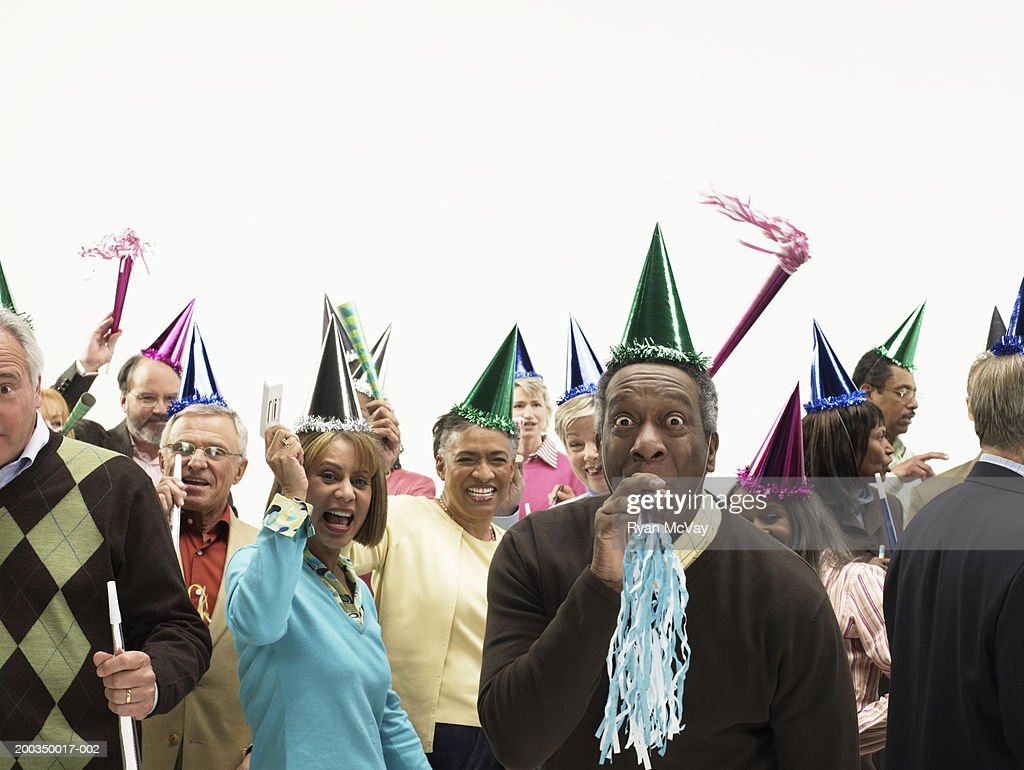 Group of mature men and women with party accessories, portrait : Stock Photo