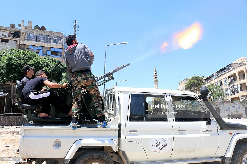 A group of members of opposition forcec attack Assad forces' helicopters after Assad forces hit residential areas with 'naval mines', thrown from helicopters in Kallese District of Aleppo, Syria on May 30, 2016.