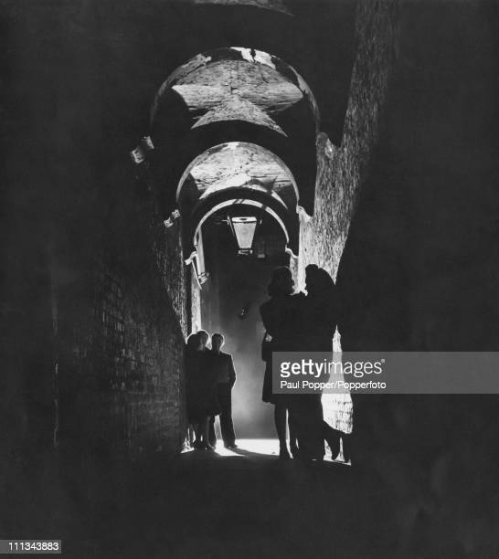 A group of men and women in a covered passageway in Soho London 1947