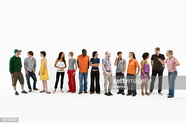 Group of men and women standing in a row and talking