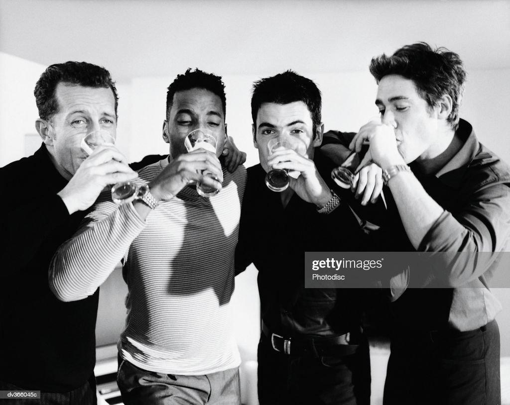 Group of men chugging beer