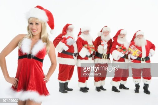 Group of men dressed as Santa Claus, Mrs Claus in foreground : Foto de stock
