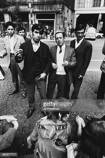 A group of men in Dam Square Amsterdam circa 1982