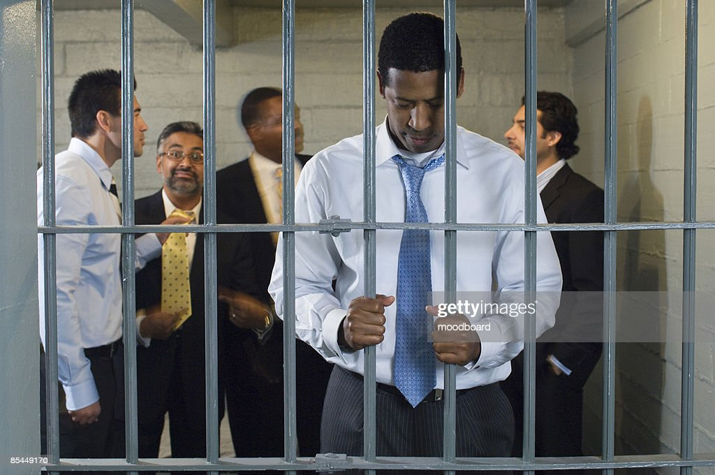Group of men in prison cell : Stock Photo
