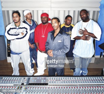 Group of men in recording studio, portrait