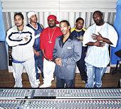 Group of men in recording studio, portrait
