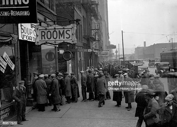 A group of men line up outside a Chicago soup kitchen opened by Al Capone ca1930s In a bid to rebuild his reputation Capone opened a soup kitchen...