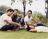 Group of Men on Grass in a Park