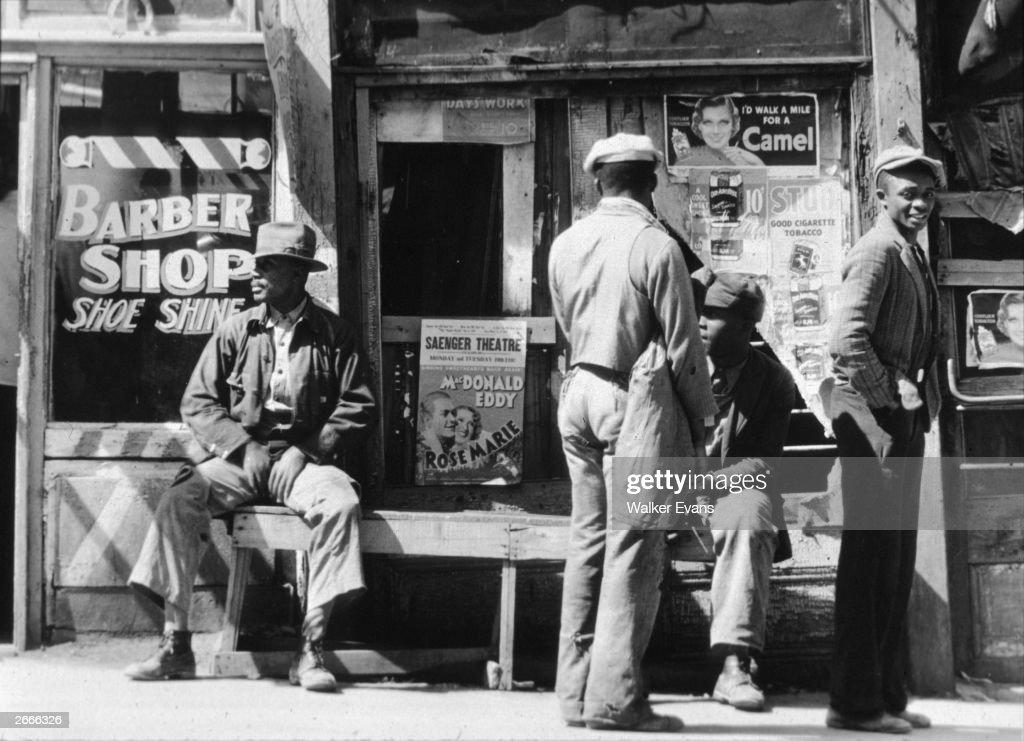 A group of men outside a barber's shop in Vicksburg, Mississippi.