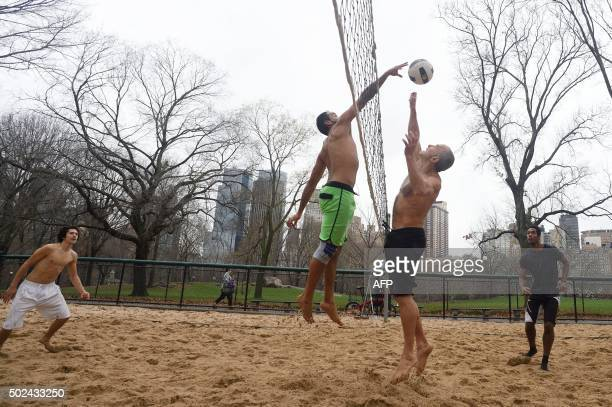 A group of men play volleyball in Central Park December 24 2015 in New York Temperatures reached 72 degrees in Central Park making it the warmest...