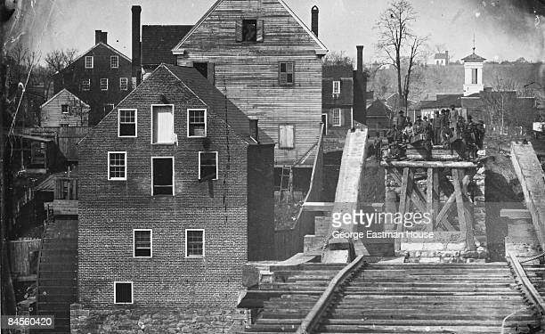 A group of men possibly Confederate soldiers gather at one end of the bridge at Fredericksburg Virginia during the American Civil War 1862 Photo by...
