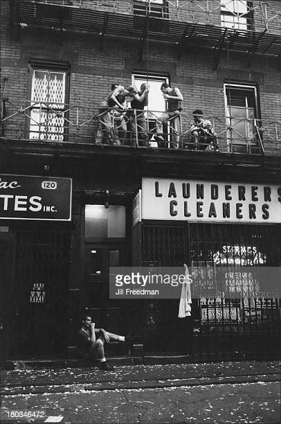 A group of men relax on the balcony of an apartment on Christopher Street West Village New York City 1983