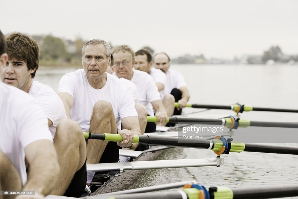 Group of men rowing