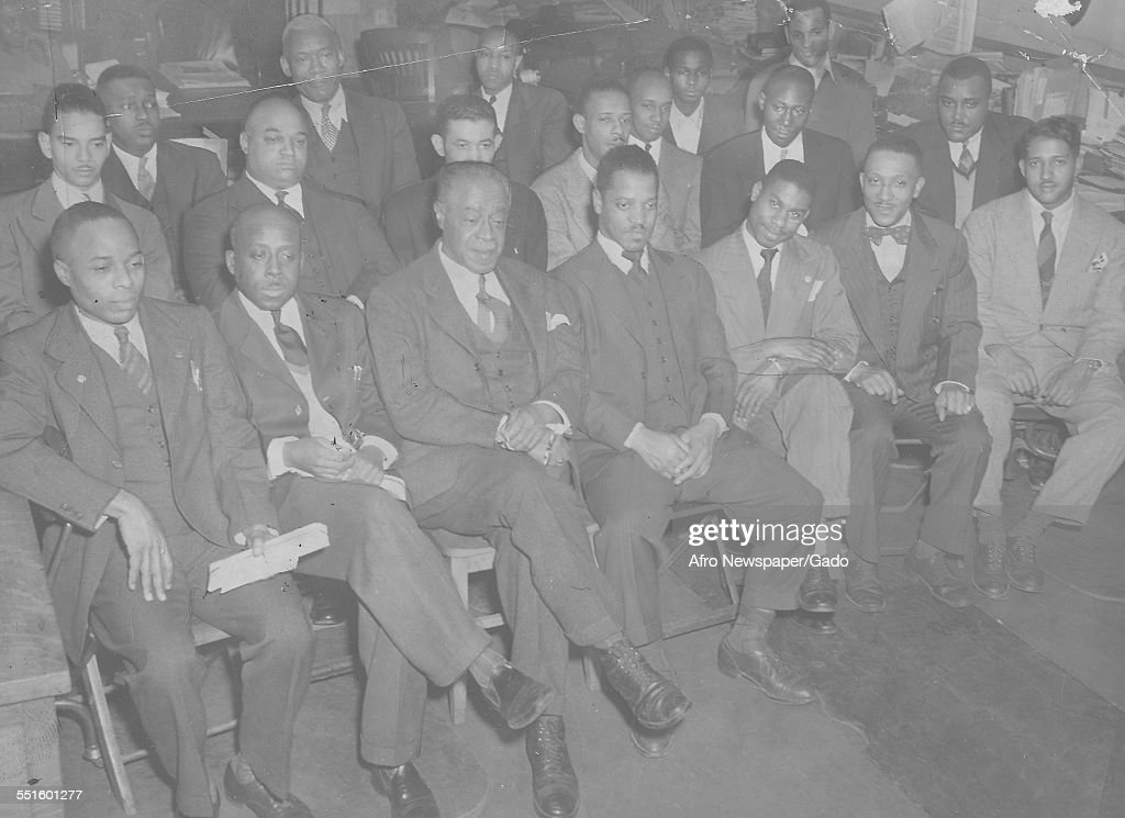 A group of men seated at a meeting in the Afro American newspaper offices, Baltimore, Maryland, 1945.
