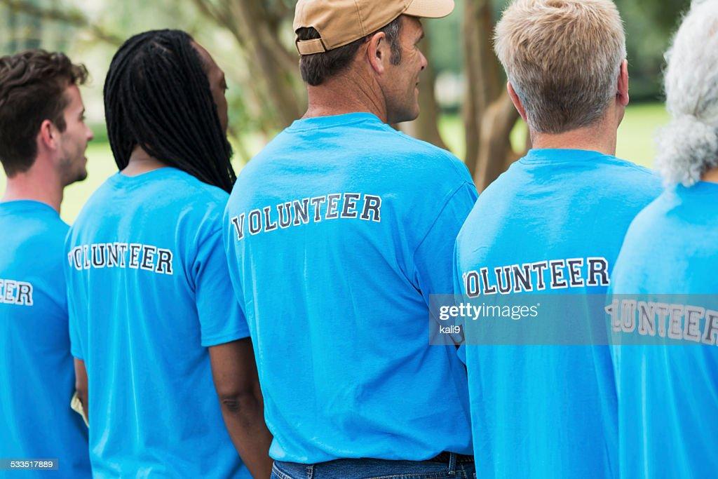 Group of men volunteering in a park : Stock Photo