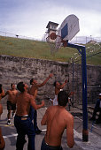 A group of Mexican convicts play a game of basketball in the yard at Old Folsom State Prison Folsom State Prison in California is located in the city...