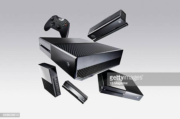 A group of Microsoft Xbox One video game consoles and a controller photographed on a white background created on November 19 2013