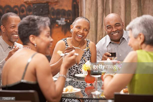 Group of middle-aged friends at dinner table