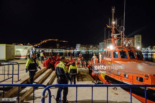 A group of migrants just being rescued in the Mediterranean sea arrives at the harbour of Malaga where the Red cross provides a first help Malaga