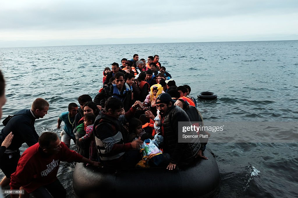 SIKAMINIAS GREECE OCTOBER A group of migrants onto the beach from Turkey onto the island of Lesbos on October 21 2015 in Sikaminias Greece Dozens of...
