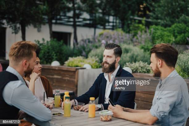 Group of millennial business people on a lunch break