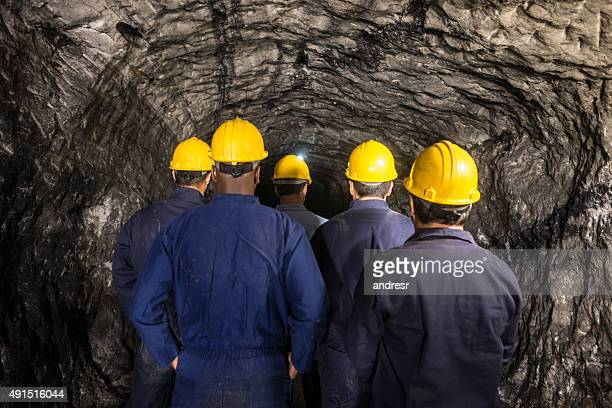 Group of miners going into a mine