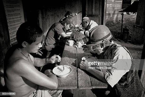 A group of miners having lunch at the Millionaire mine They work simply for food spending 12 hours underground each day with virtually no safety...