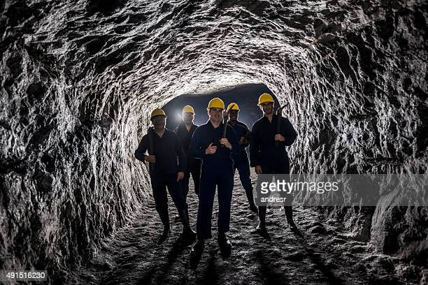 Group of miners in a mine underground