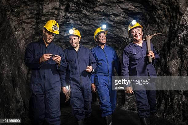 Group of miners mining underground