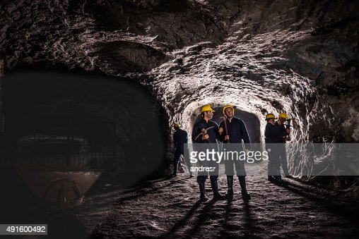 Group of miners working at a mine