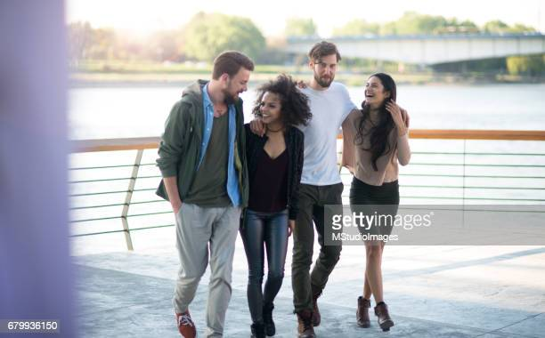 Group of mixed race friends outdoors