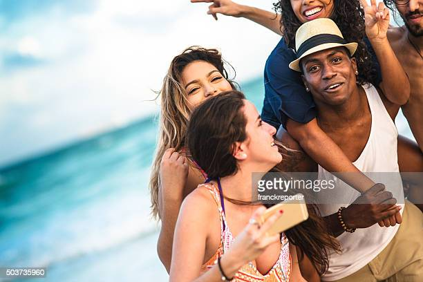 Group of mixed race friends take a selfie in miami
