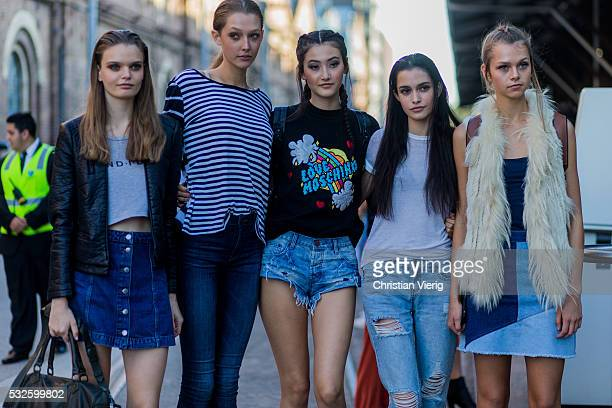 A group of models wearing denim at MercedesBenz Fashion Week Resort 17 Collections at Carriageworks on May 19 2016 in Sydney Australia