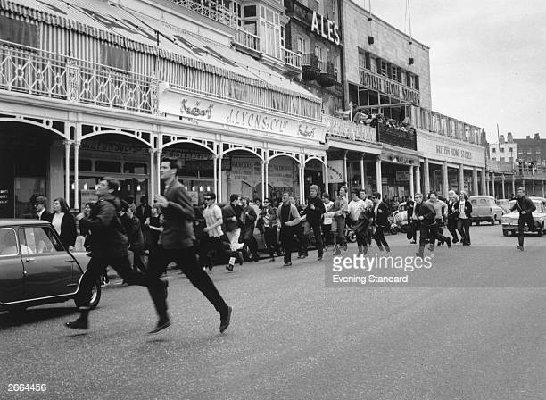 A group of Mods run along the street in Margate Kent after a violent clash between Mods and Rockers