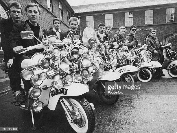 A group of mods with their decorated scooters outside the Labour Exchange in Peckham south London 8th May 1964