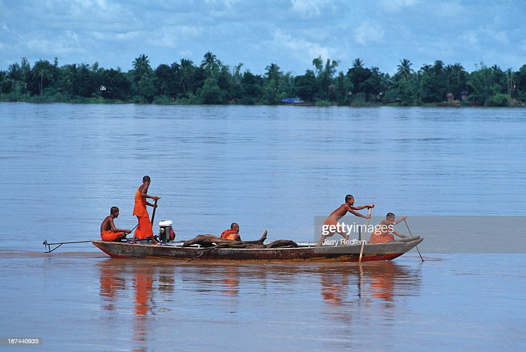 A group of monks from a nearby Wat try to row back upstream to their temple on the Mekong at flood stage in Kratie. They made no headway, and after half-an-hour they docked in town..