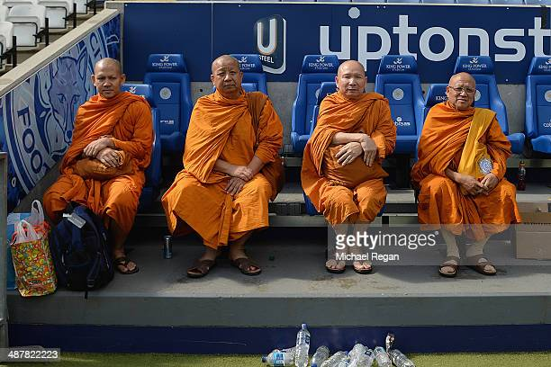 A group of monks sit on the Leicester bench after the Sky Bet Championship match between Leicester City and Queens Park Rangers at The King Power...