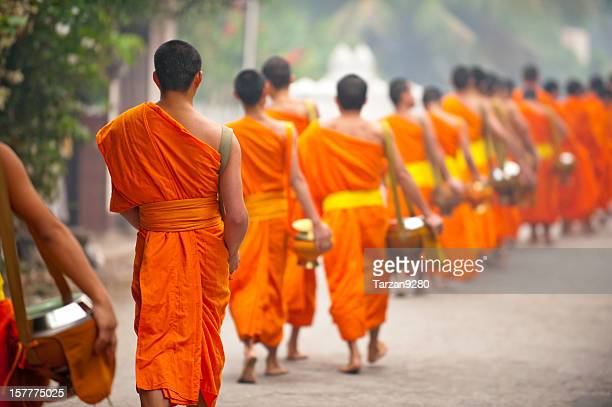 Group of monks walking in street, Laung Prabang, Laos