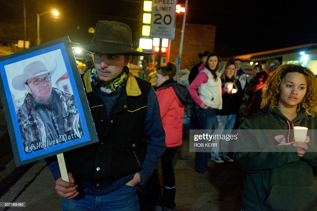 A group of more than 20 people marched up and down N Broadway Avenue in Burns Oregon January 27 holding a candlelight celebration of the life for...