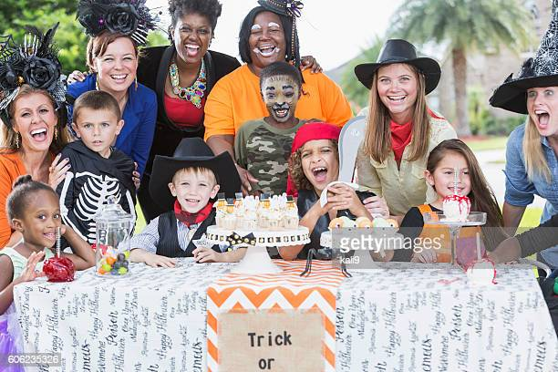 Group of mothers and children at Halloween party
