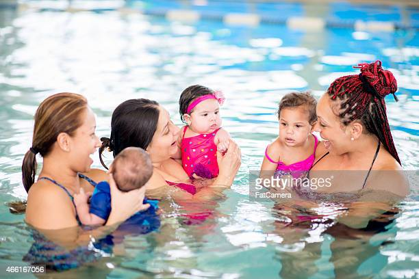 Group of mothers and children at the pool