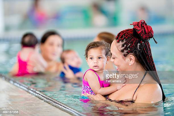 Group of mothers taking their children swimming