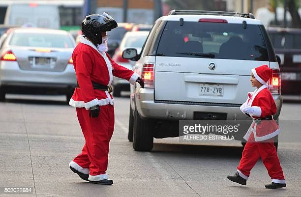 A group of motorcyclists fancy dressed as Santa Claus parade during an event called 10th Edition of the Santa On Two Wheels in Mexico City on...
