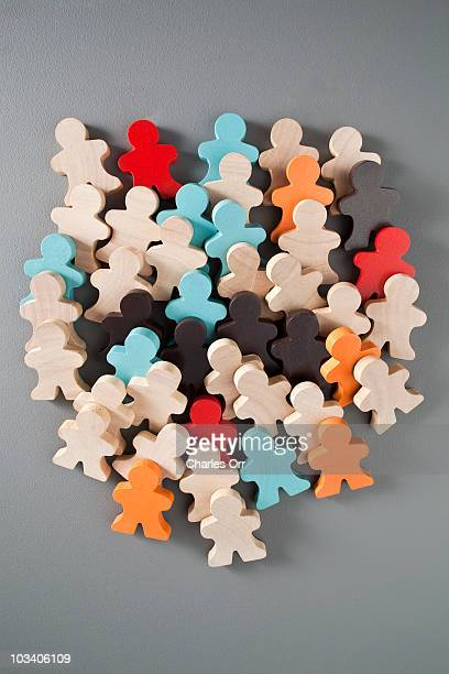 A group of multi colored wooden stick figures