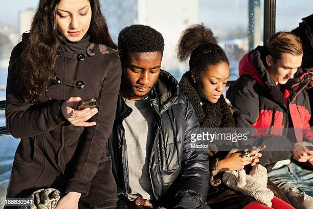 Group of multi ethnic friends using mobile phones