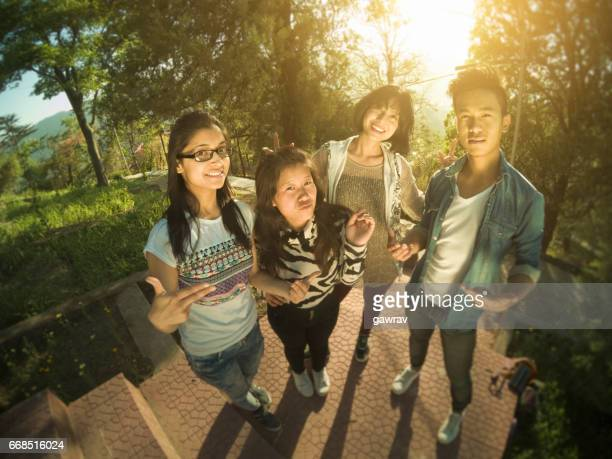 Group of multiethnic college friends posing for selfie.